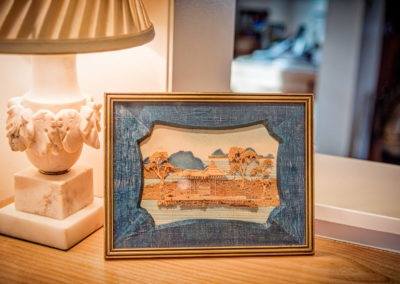 Antique finds that, combined, make a magical vignette. Silk and cork framed asian art (era unknown). Small marble lamp with a custom shade. Absolutely fantastic at night.